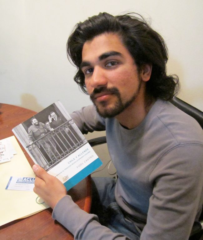 """Steve """"Chiru"""" Singh Gill, 22, a political science major, reads about Chile"""