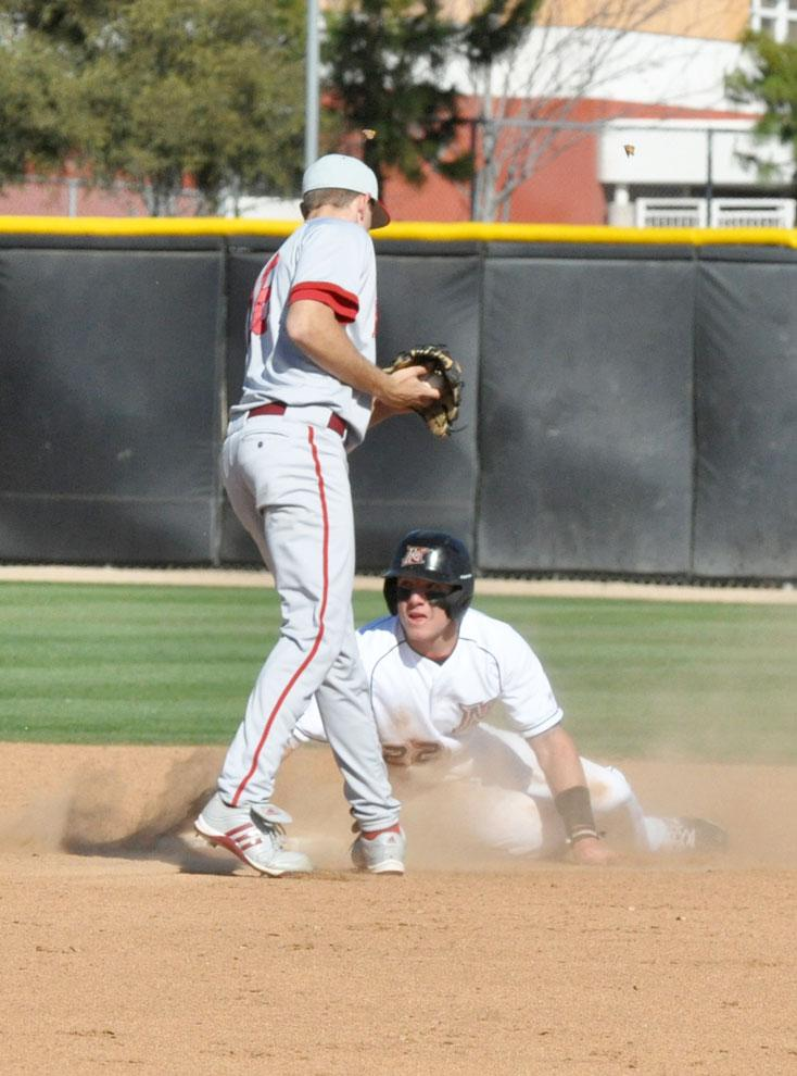 CSUN outfielder Adam Barry tags home plate during their game against Rhode Island. The Matadors find their offensive rhythm at LMU. Photo Credit: Kiera McKibbens / Contributor