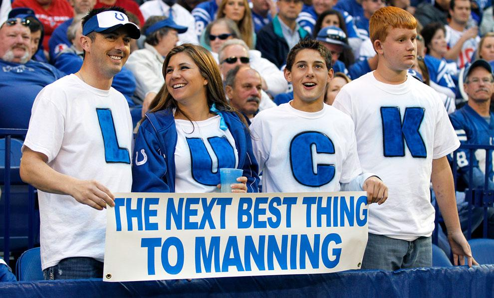 Fans show support for 2012's expected No. 1 draft pick (Andrew Luck)  in a November game at Indianapolis. The Colts, reportedly, will release Peyton Manning today.