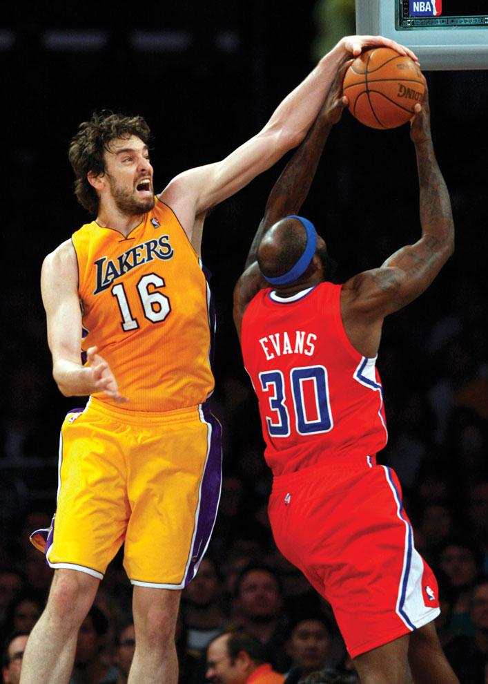 The Lakers' Pau Gasol blocks a shot by the Los Angeles Clippers' Reggie Evans (30) in the second quarter of a Jan. 25 game at the Staples Center. Gasol has been at the center of numerous trade rumors around the NBA. The trade deadline is Thursday. Courtesy of MCT