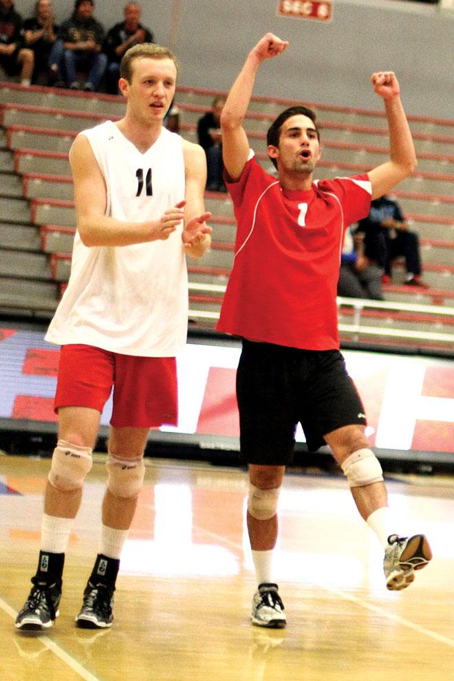 Matt Stork, 11, celebrates with Charlie Condron, 1, in the midst of CSUN's 3-0 win against Ball State Wednesday night. The Matadors got their first home sweep of the season.  Photo Credit: Misael Virgen / Daily Sundial