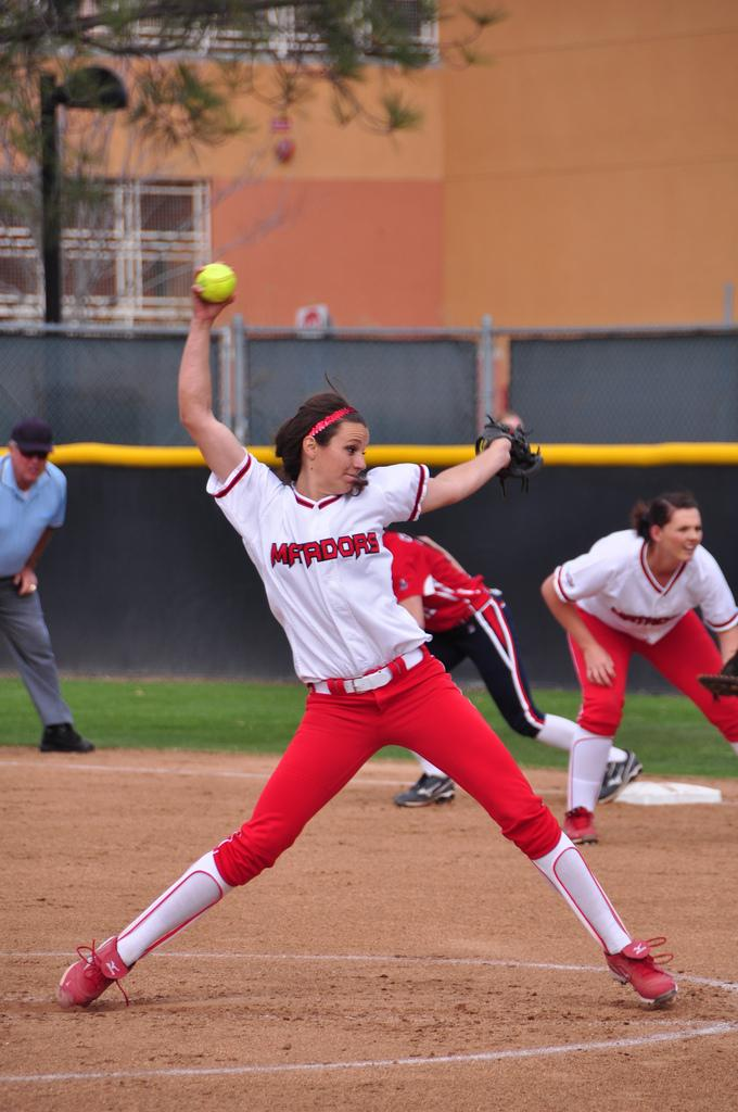CSUN pitcher Mia Pagano winds up for a pitch against USSSA. Pagano carried the Matadors to a victory against Cal Poly with a grand slam and stellar pitching Saturday afternoon.