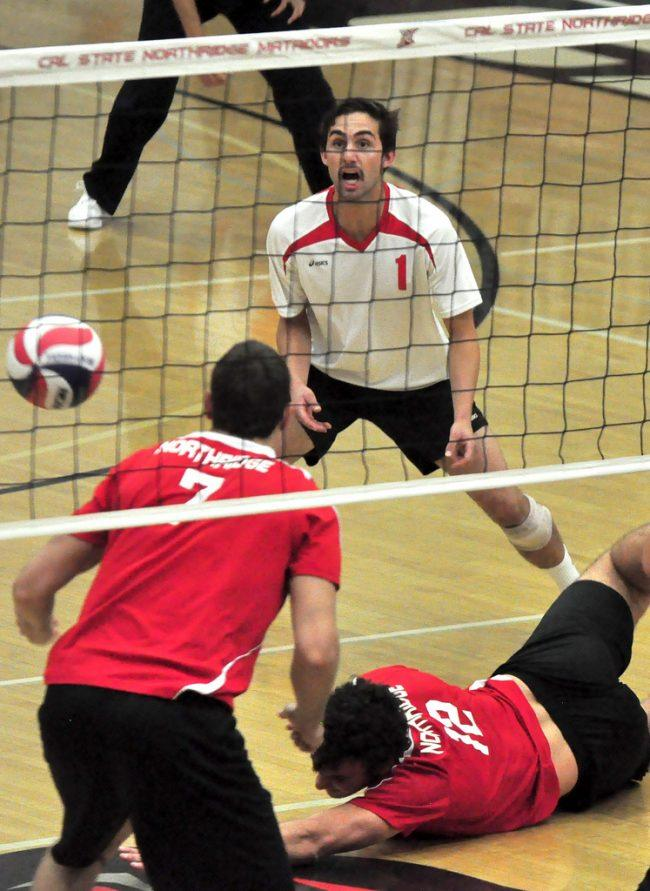 CSUN libero Charlie Condron (1) eyes the ball as teammate Julius Hoefer (12) tries to come up with a dig against Hawai'i on March 23. The Matadors came back against Stanford to send the game to five sets, but their efforts came up short. Photo Credit: Tessie Navarro / Multimedia Editor