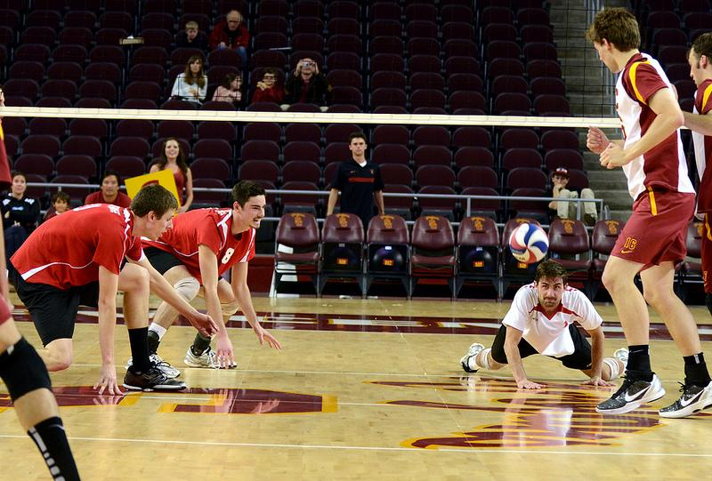 CSUN players Jared Moore, Kyle Stevenson, Charlie Condron miss a spike by USC. Photo credit: Jonathan Andrade / Daily Sundial