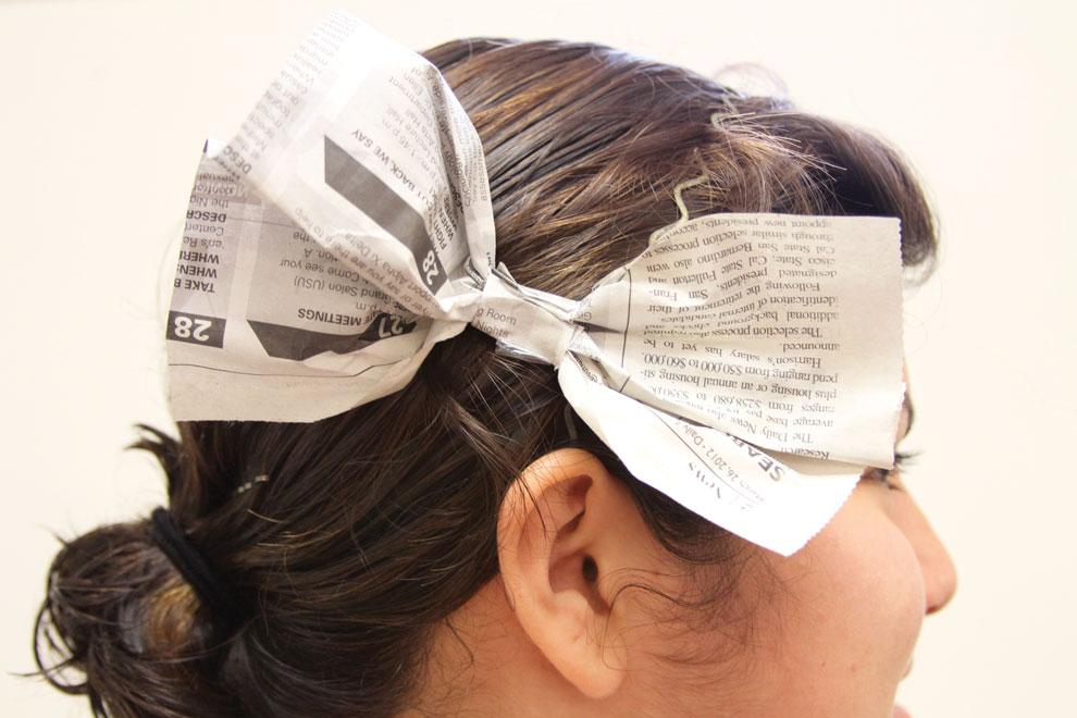 The newspaper hairpiece is just one way to creatively recycle used newspapers. Photo credit: Mariela Molina / Photo Editor
