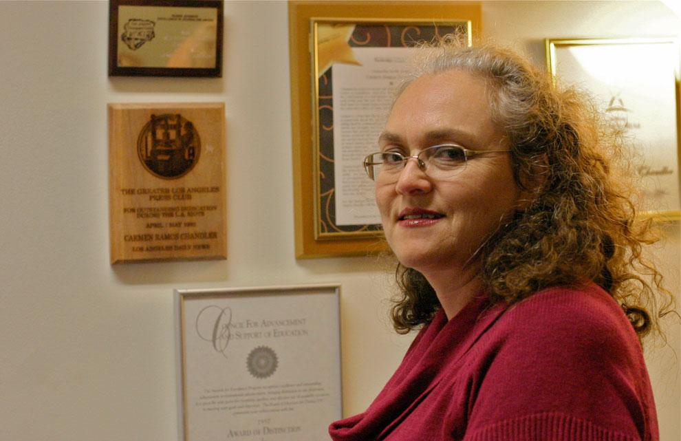 Carmen Ramos Chandler, CSUN director of news and information, stands in her office next to her Greater Los Angeles Press Club Award, for which she was recognized for her outstanding coverage as a reporter for the Los Angeles Daily News during the 1992 Los Angeles riots. Photo credit: Trisha Sprouse / Daily Sundial