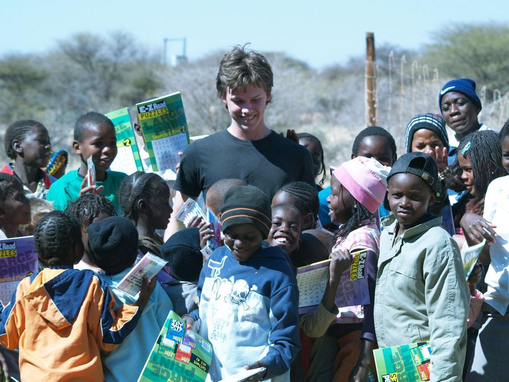 CTVA junior Devon Frankel, center, smiles among the children he worked with during a four-week vacation in South Africa in 2009. The children's schoolhouse was in an abandoned tire factory, and Frankel provided them with crossword