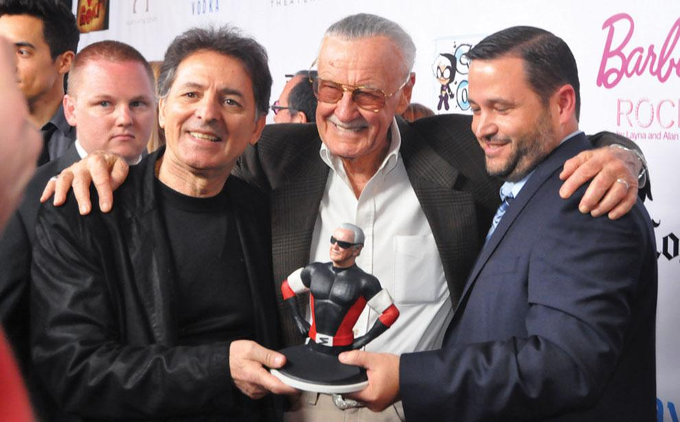 Stan Lee (center) on the red carpet of the premier of his film
