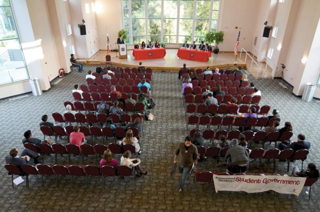 Assemblyman Cameron Smyth, Senator Kevin De Leon and two members of the busniness community hold a town hall meeting for a less than one-third filled Grand Salon.  Big Politics aimed at giving students a chance to hear from elected officials and interact with them, but few students took advantage of the event. Photo credit: Ken Scarboro / Editor in chief