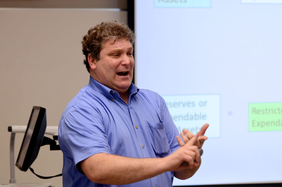 Accounting professor from Eastern Michigan Univiersity, Howard Bunsis, explains restricted and unrestricted funds in the CSU budget.  Bunsis explained that the CSU is not broke as it claims to be, but is actually making a profit. Photo credit: Ken Scarboro / Editor in chief