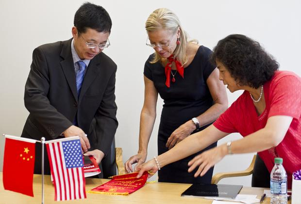 President Diane Harrison signs an MOU with Central China Normal University. President of CCNU, Zongkai Yang, on the left, and Dr. Justine Zhixin Su, CSUN coordinator of international programs and director of the China Institute, is on the right. Charlie Kaijo/Assistant Photo Editor