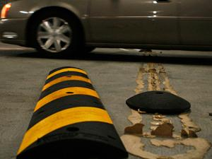 Newly installed speed bumps fall apart on the first day of school