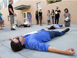 Students use performance art to raise awareness of smoking related diseases and deaths
