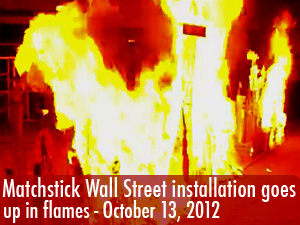 Burning Wall St. exhibit goes up in flames