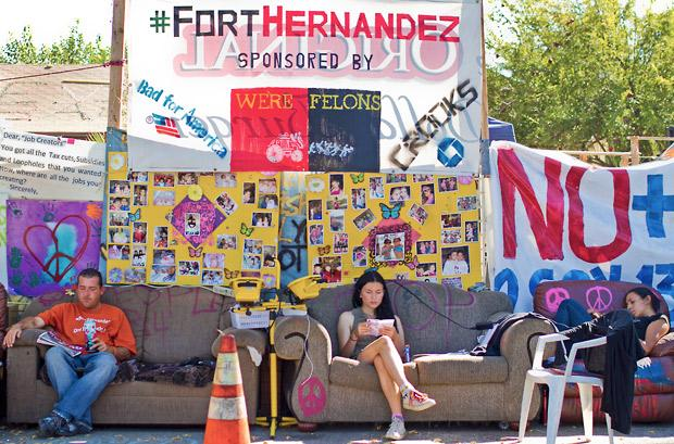 Members of Occupy San Fernando Valley wait for the Hernandez family to return from the police station after filing a complaint on LAPD following numerous visits to the house. The home has been dubbed â??Fort Hernandez.â? The house was turned into a camping ground for many who have lost their homes in bank foreclosure. Fort Hernandez has become the heart of one of the local Occupy movements, Occupy San Fernando Valley.