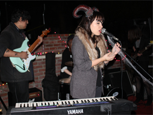 Oksana Borodyanskaya, 22, a communication studies major in her junior year, sings and plays keyboard for Doctor Hoogo at this year's Meow Fest on Oct. 26. She  was one of the organizers for this year's Halloween-themed Meow Fest.