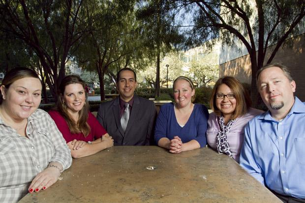 Master of Social Work students, Amy Plaster, Katie Cianci, Jamie Biggs, Sandra Sharma, and Keven Trout, and Professor of Social Work, Jose Paez (center left) in front of Sierra Hall. The group advocated to limit the use of solitary confinement for juveniles in correctional facilities. Their efforts included contacting opposition, researching prior recommendations on juvenile solitary confinement, and a change.org petition sent to Senator Leland Yee's office to introduce the bill. The Bill SB61 was introduced on Jan. 8. Photo credit: Charlie Kaijo / Senior Photographer