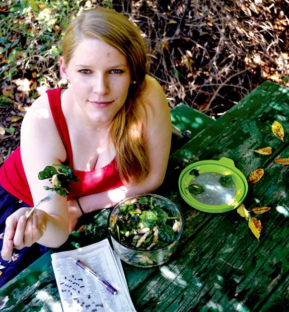 Heather Swann, 20, junior microbiology major and vegetarian enjoys a refreshing salad at the CSUN Botanical Gardens.  Photo credit by John Saringo-Rodriguez/ Daily Sundial