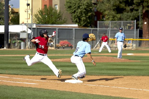 Sophomore infielder Michael Livingston (35) beats the ball to first base in Tuesdays win against University of San Diego. Photo credit by Nathan McMahon/Opinion Editor