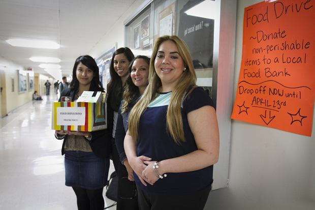 Masters of social work students, Adriana Rubio, Patricia Franco, Elizabeth White, and Michaela Chapman by the social work office in Sierra Hall. They have set up food collection boxes for the Valley Food Bank and the Hope of the Valley Rescue Mission for a social work project on hunger issues in Northridge. They have five food collection boxes on campus. Photo credit by Charlie Kaijo / Senior Photographer