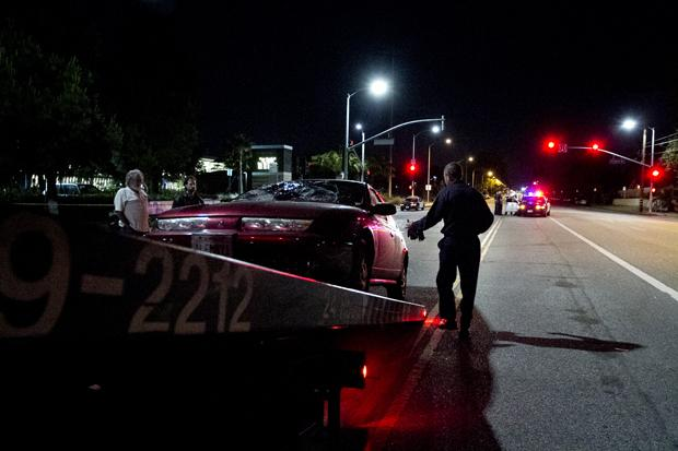 A vehicle is towed on the corner of Zelzah and Praire. A man mistaking a green light for a turn signal struck two CSUN students crossing the street. The students, a male and a female, are in stable condition. The male suffered a broken leg. Photo credit by Charlie Kaijo / Senior Photographer