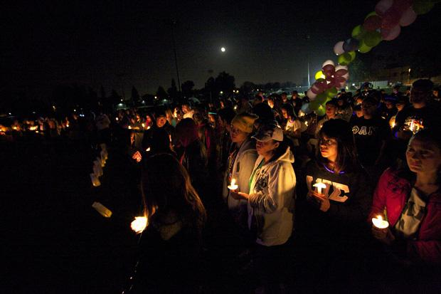 More than 100 people participated in the Relay for Life candlelight vigil on Saturday night to honor those who have lost their lives to cancer. Photo credit: Loren Townsley / Photo Editor