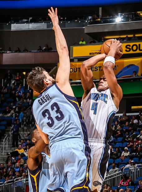 Grizzlies center Marc Gasol (33) extends to challenge a jumpshot by Magic guard Aaron Afflalo. Courtesy of MCT