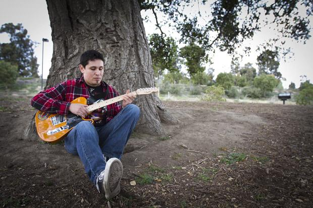 Religious studies major, Adam Cabral, at the Pleasant Valley Sports Park near his home in Camarillo. Cabral said he found religious studies and writing music as an outlet for built-up emotions after the September 11th attacks. Photo credit by Charlie Kaijo/ Senior Photographer