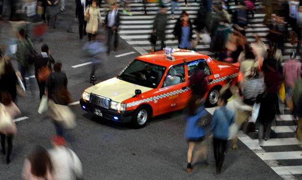 A taxi is in the middle of a bustling crosswalk in Shibuya, Tokyo, a city with a population of roughly 200,000 residents with thousands of visitors each year, according to the Japan National Tourism Organization. Photo credit: John Saringo-Rodriguez / Daily Sundial