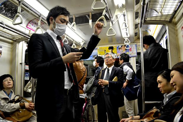 A common sight in heavily populated locations in Japan are people who wear face masks.  Those who wear face masks do so when they are sick or as a preventative measure to protect themselves from allergies or other people's germs. Photo credit: John Saringo-Rodriguez / Daily Sundial