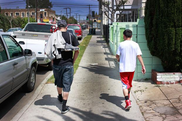 When he's not cutting hair--he closes his shop on Sundays--Alonso Romo likes to play basketball at Evergreen Park in Boyle Heights with his friends, many of which are regular customers to his barber shop. Photo credit: Luis Rivas / Senior Reporter