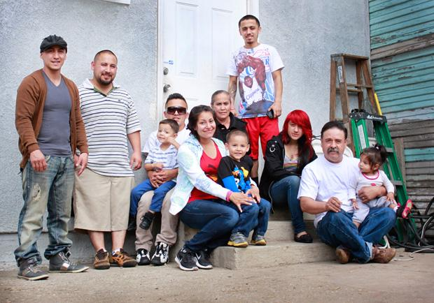 The Romo family share a single-story home in Boyle Heights where three generations of family members live under one roof. Photo credit: Luis Rivas / Senior Reporter