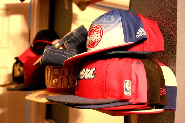 "Romo is a die-hard Los Angeles Clippers fan. He collects Clippers memorabilia, such as posters, shirts and hats. His loyalty to the team was a huge factor in his barber shop, LA City Clips. ""Clips"" has a double meaning, one for barber clippers and also for the basketball team, Romo said. Photo credit: Luis Rivas / Senior Reporter"