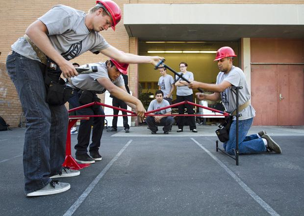The CSUN chapter of the American Society of Civil Engineers' (ASCE) Steel Bridge team assembles a 92 pound bridge they designed in preparation for the ASCE Nationals taking place in Washington on May 31. They will be competing for fastest time against teams from MIT and UC Berkeley. Photo credit: Charlie Kaijo / Senior Photographer