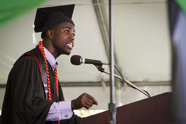 Political science major with a concentration in law and society, Joshua Thompson, gives a speech to CSUN graduates during the black graduation ceremony held at the lawn behind Manzanita Hall, Sunday. Photo credit by Charlie Kaijo/Senior Staff