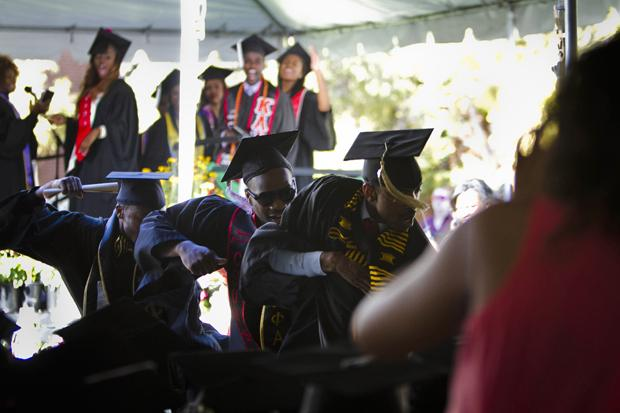 Enthused graduates dance in celebration of receiving their diplomas during the Black graduation ceremony, Sunday. Photo credit by Charlie Kaijo/Senior Staff