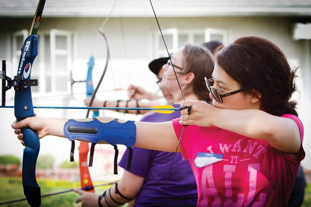 Engineering major, Primepissa Honglocksanapan, readies her bowstring before taking a practice shot at the CSUN Archery club meeting. Photo credit by Charlie Kaijo / Senior Photographer