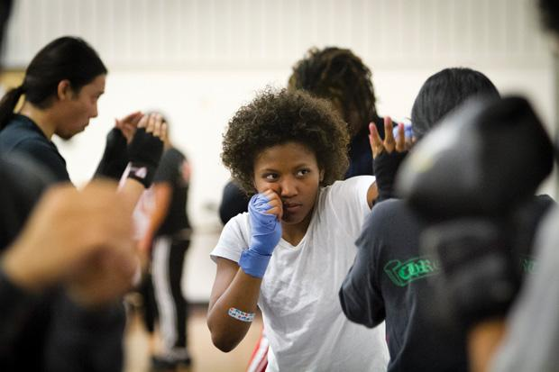Tiffany Randle, media management major, practices jabs with a partner at the CSUN Boxing Club meeting. Photo credit by Charlie Kaijo / Senior Photographer