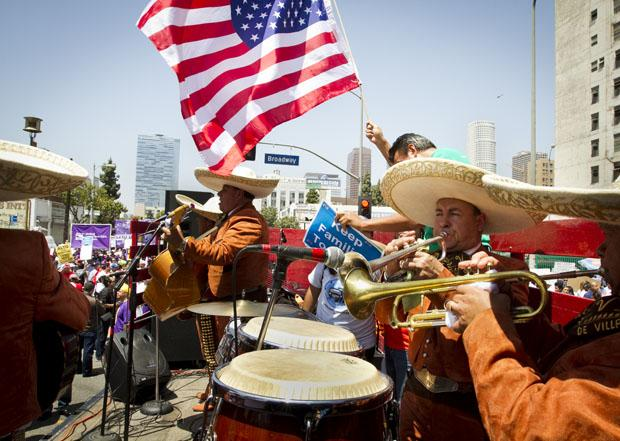 A Mariachi band performs for May Day participants at a rally on Olympic Boulevard and Broadway Street. Photo credit by Charlie Kaijo / Senior Photographer;