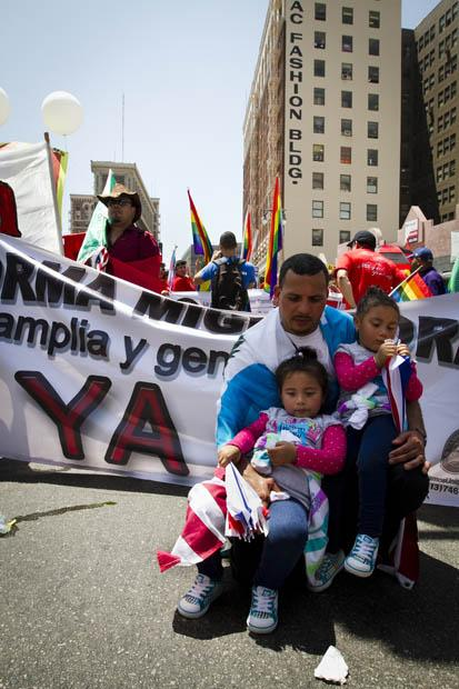 Luis Arredondo and his daughters, Alison and Mylin, at the May Day rally at Olympic Boulevard and Broadway Street. Photo credit by Charlie Kaijo / Senior Photographer