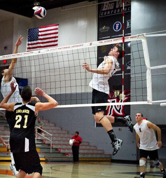 Setter Travis Megorien sets up senior middle blocker Jared Moore for an attempted kill. File Photo / Daily Sundial