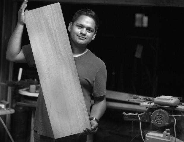 Esteve Mena, 23, is finally ready to build his own jarana guitar. Mena poses with a piece of African mahogany, which he's using to make the jarana.