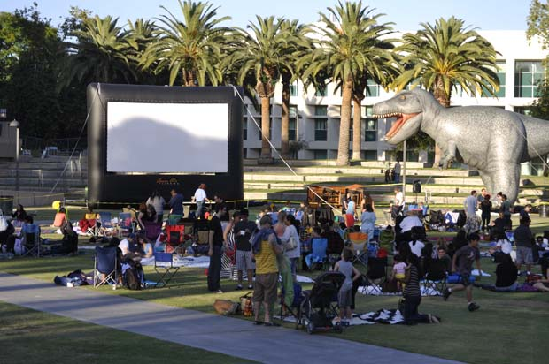 """CSUN Summer Movie Fest shows """"Jurassic Park"""" on June 20. The audience is spending time before the movie starts. Photo credit: Risa Akita / Daily Sundial"""