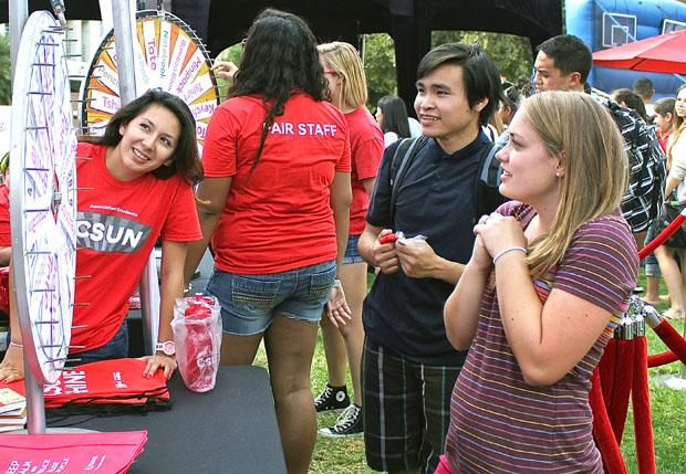 Jenel Bloom, 21, kinesiology major awaits for her prize after spinning the wheel during the A.S Fair, at the bookstore lawn on Tuesday, August 27. Photo credit: Lucas Esposito / Daily Sundial