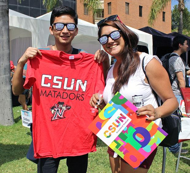 CTVA student Anthony Gaona, 21, and Deaf Studies major Cindy Diaz, 21, show the giveaways they obtained during the A.S Fair, at the bookstore lawn, Aug. 27. Photo Credit: Lucas Esposito / Daily Sundial