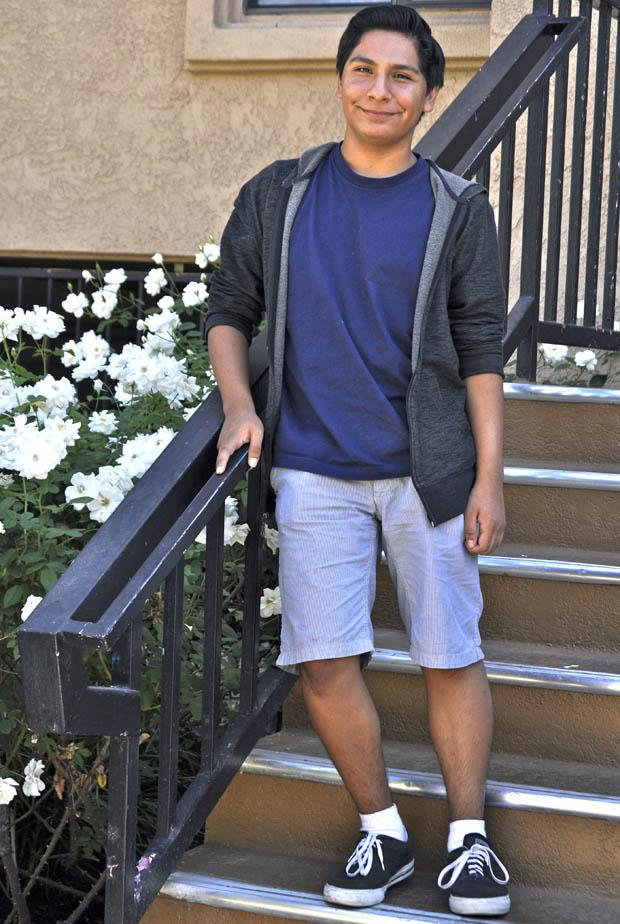 Pablo De La Cruz, freshman, a communications major, stands on the steps of his new apartment near campus. He is excited to be able to walk to his classes. Photo credit: Elizabeth Ohanian / Daily Sundial