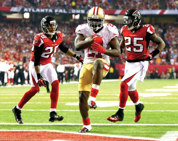 San Francisco 49ers runningback Frank Gore splits two Atlanta Falcons defensive backs for a touchdown in last year's NFC championship game. Photo credit: MCT