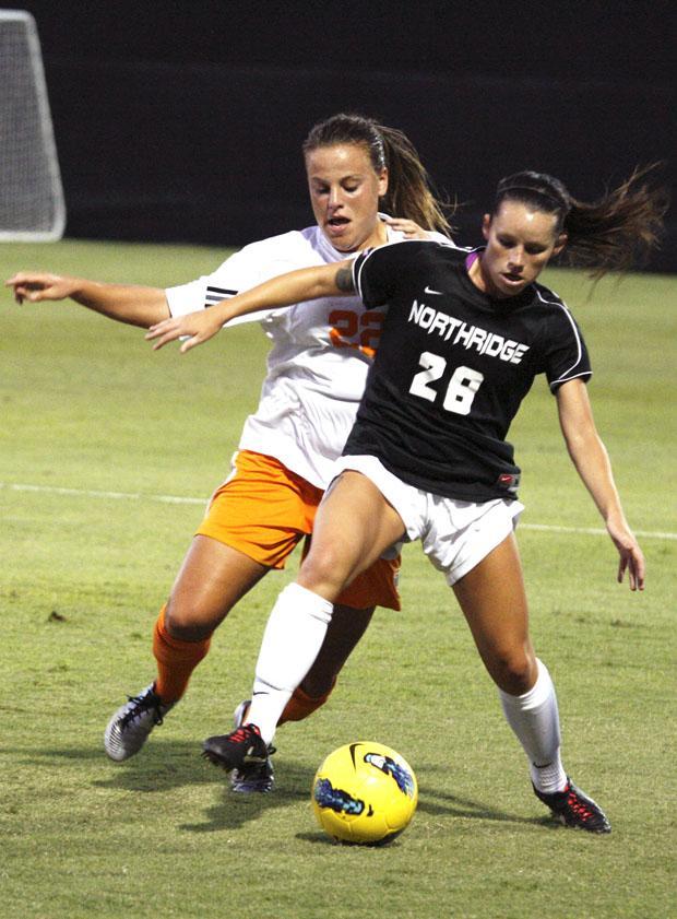 Sophomore forward Lyndsey Preston battles a Tennessee defender. File Photo