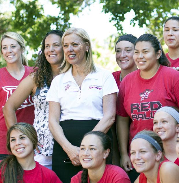 CSUN president, Dr. Dianne F. Harrison, poses for a photo with members of the CSUN softball team during the annual President's Picnic at the Bayramian Hall Lawn on Aug. 28, 2013. Photo credit: Trevor Stamp / Daily Sundial.