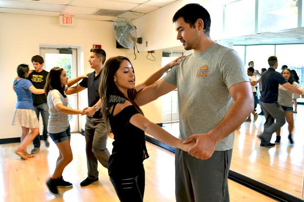 Chemistry major, Yvonne Diaz, 21, CSUN Ballroom Club president and Jonathan Acuna, 27, astro physics major, practice posture while moving their hips and legs to the beat of the music. Photo credit: John Saringo-Rodriguez / Photo Editor
